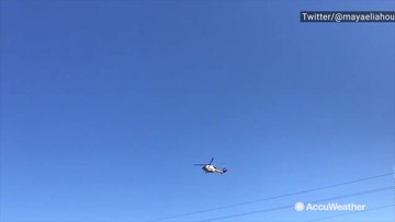 Helicopters fly over burning Palisades fire