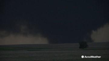 Large wedge tornado swirls ominously at night
