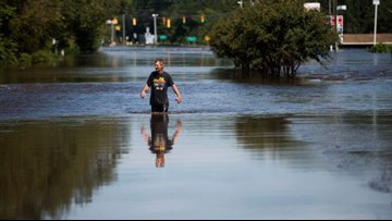 This man waded a mile and a half through floodwaters for love, cigarettes