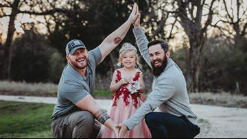 Photographs of two Texas fathers and their daughter go viral