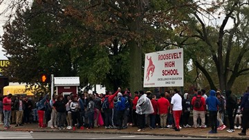 Students walk out in support of fired football coach at Roosevelt High School