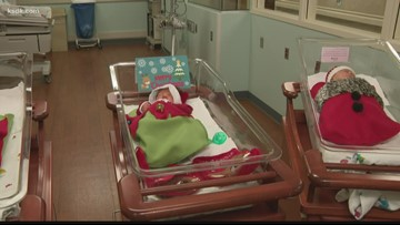 Babies born on Christmas decked out in holiday-themed outfits