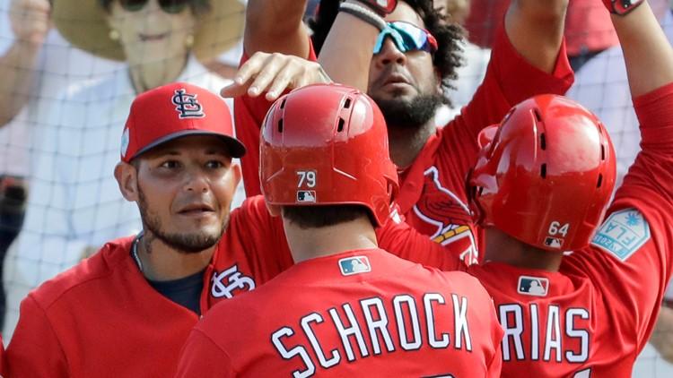 Cardinals start grapefruit league play with offensive outburst