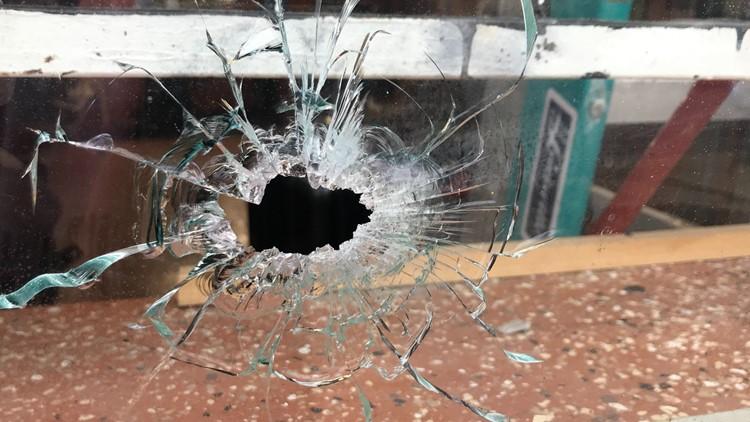 Bullet hole in barber shop