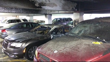 Why did it take so long for abandoned cars to be removed from city-owned parking garage?