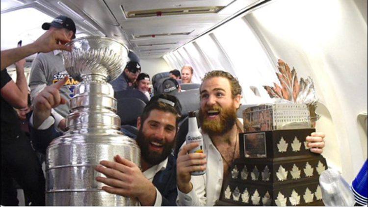 St. Louis Blues celebrate on the plane ride home after winning Stanley Cup.