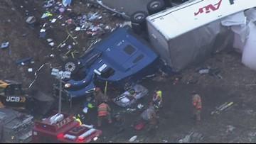 Raw: Truck plows through semi's trailer, splitting it in half on icy Illinois ramp
