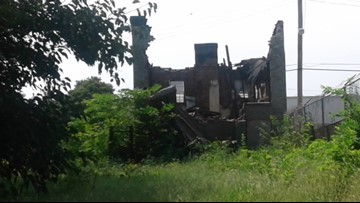 Pastor says falling bricks on Paul McKee property endanger churchgoers
