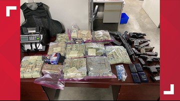 Police take guns, $300,000 during search warrant in south St. Louis