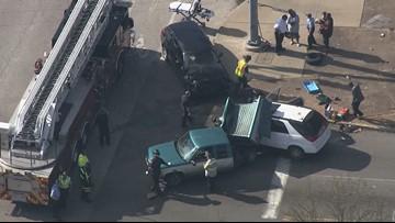 1 injured in multi-car crash involving school bus