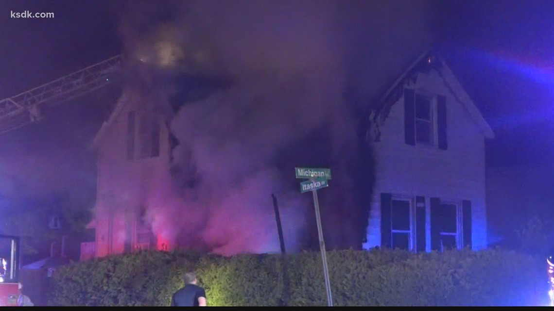 Firefighters run into burning home to rescue woman trapped in bathroom