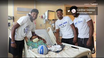 SLU basketball players visit children in hospital