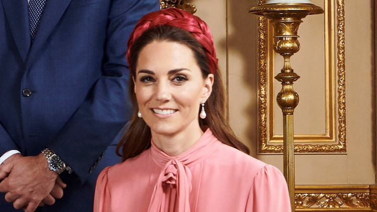 Kate wears a red headband