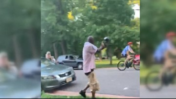 Angry man shoots at naked bicyclists with paintball gun during World Naked Bike Ride