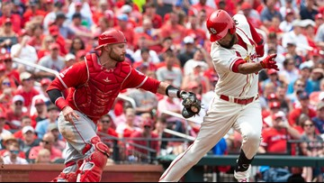 Fans celebrate Pujols homer and Cardinals win