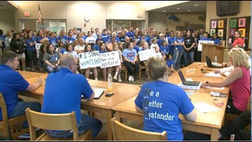 Students and parents rally behind superintendent on leave