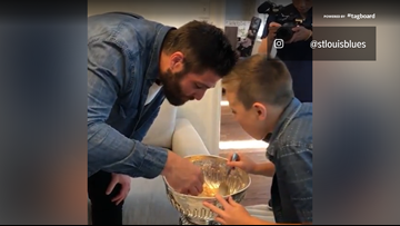 Breakfast of champs | Patrick Maroon and son eat cereal out of Stanley Cup