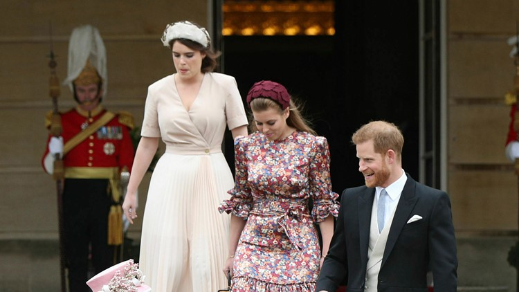 Princesses Eugenie and Beatrice with Prince Harry at a garden party