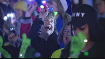 Hundreds shine lights to show support for children at Cardinal Glennon