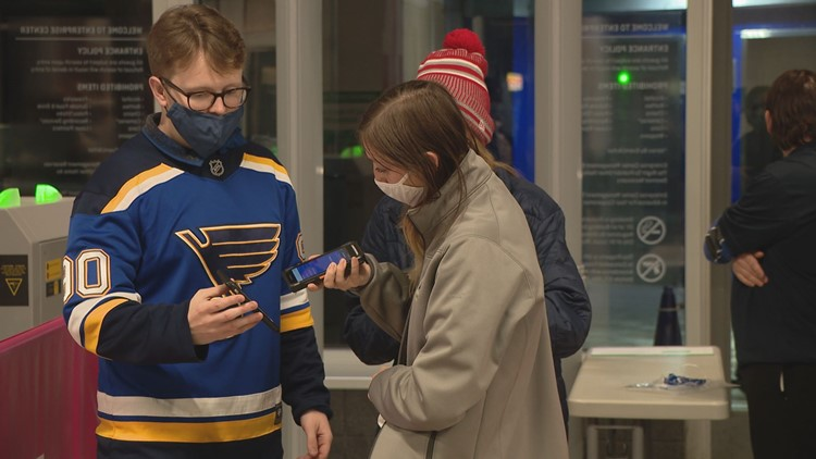 Fans follow new COVID-19 requirements at Blues home opener