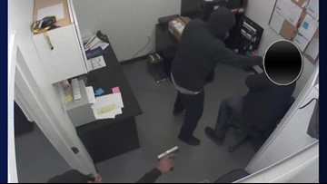 WATCH: Men wanted for robbing Sprint store at gunpoint