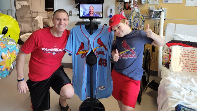 Boy recovering from brain tumor meets his Cardinals hero