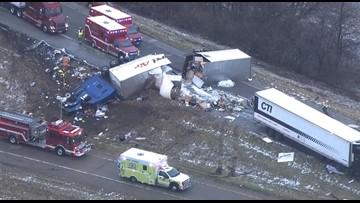 Truck plows through semi's trailer, splitting it in half on icy Illinois ramp