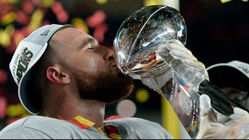 Travis Kelce invents the 'Lombardi Luge,' chugs beer off trophy