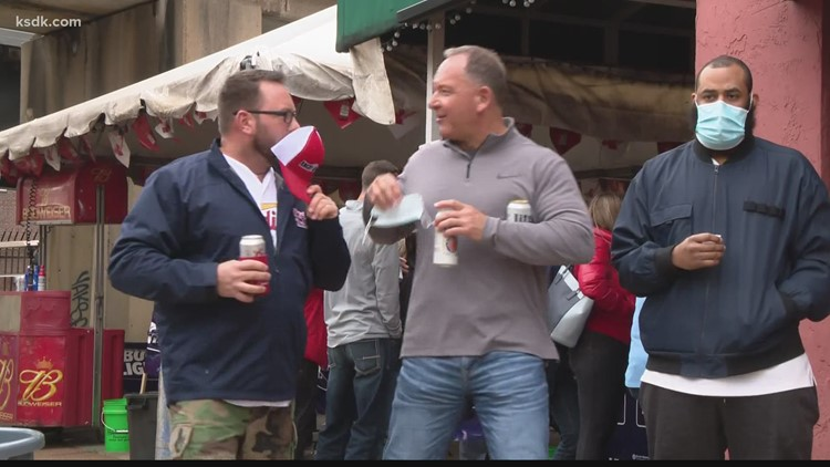 'We're not to the old days yet' | Opening day crowds give hope to struggling St. Louis bars, restaurants