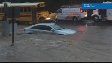 Flash flooding turns roads into rivers