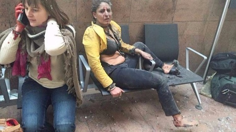 The story behind the Brussels photo you saw everywhere: 'I was not able to help them'