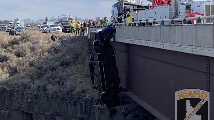 Camper chain kept pickup from falling into Idaho gorge, police say