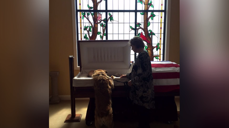 'They bonded; they belonged together' | NC dog leans over casket to tell 'Daddy' goodbye