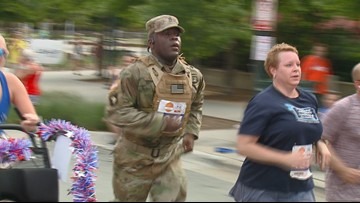 'I've known folks who've died for that flag' | Soldier completes Freedom Run in full gear, carrying American flag
